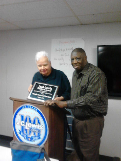 Dr. Jack Lewis receives an award